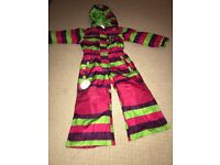 Pink, purple and green striped girls all in one ski suit