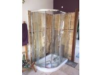 glass shower enclosure including matching stone composite tray