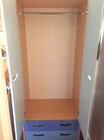 Child's bedroom wardrobe and small set of drawers.