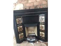 Victorian style cast iron insert fireplace tiled