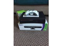 Xbox 360 with a wireless controller, Kinect sensor and games. Great condition.