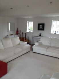 2 x White leather two seater sofa's