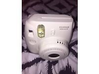 white Instax mini8 fujifilm camera