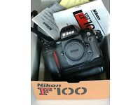 Nikon F100 35mm Film Camera Body only with MB-15 Battery pack.