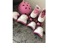 Girls size 1 roller boots, elbow/knee pads and matching helmet