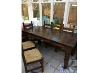 solid table with 6 chairs, very good condition