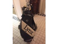 Full Set of Lynx Golf clubs bag trolley shoes balls tees etc