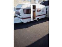 Four birth vintage caravan