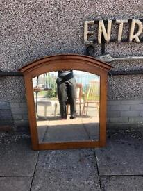 Large wooden framed mirror.