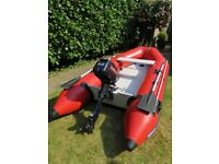 Evinrude 5HP engine and free boat as in need of seam repair.