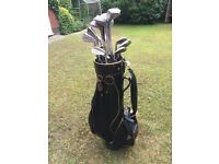 Full set of right handed Wilson Irons, various metal woods, plus golf bag