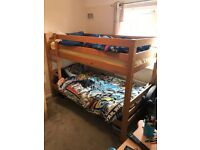 Wooden bunkbeds with mattresses