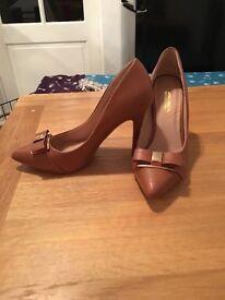 Heels hardly worn
