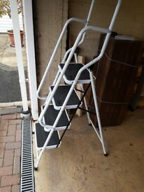 Four step folding ladder ~ never used.