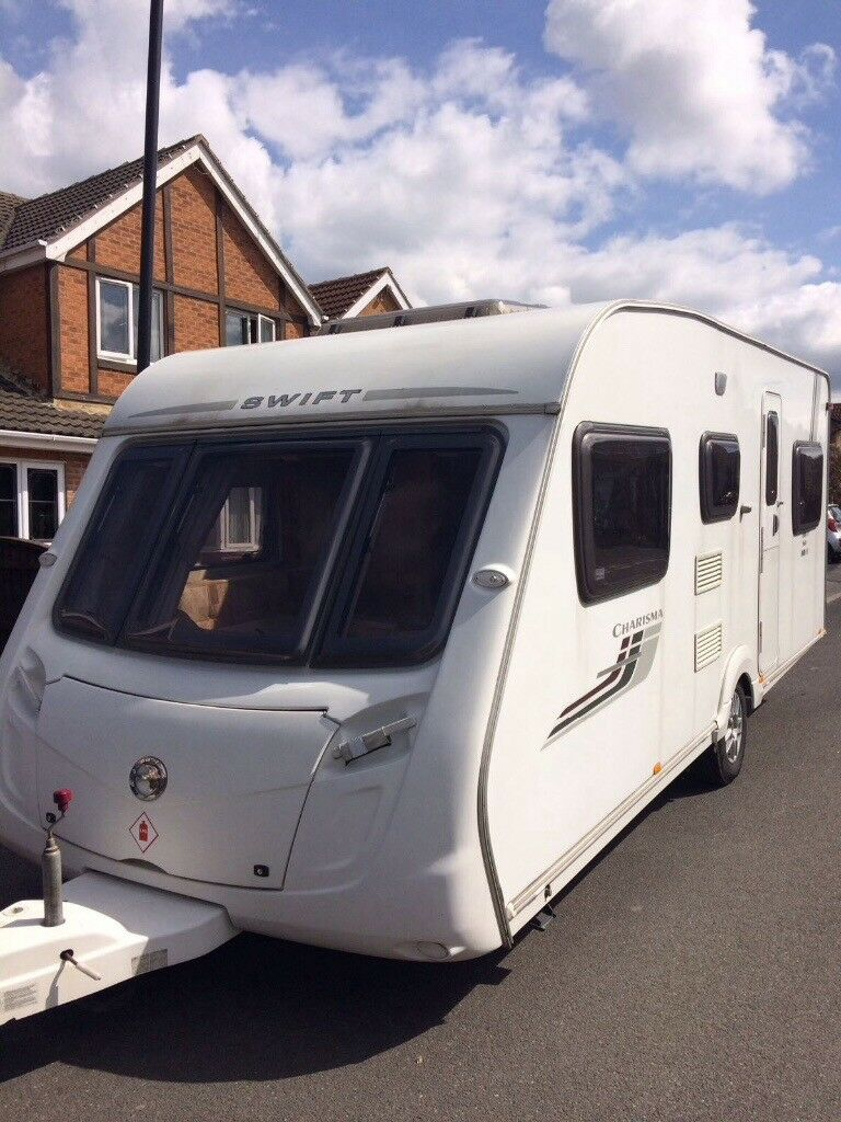 Swift Charisma 565 6 Berth Caravan 2009 Triple Bunk Full and Porch Awning