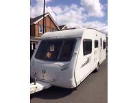 Swift Charisma 565 6 Berth Caravan 2009 Triple Bunk Full and Porch Awning