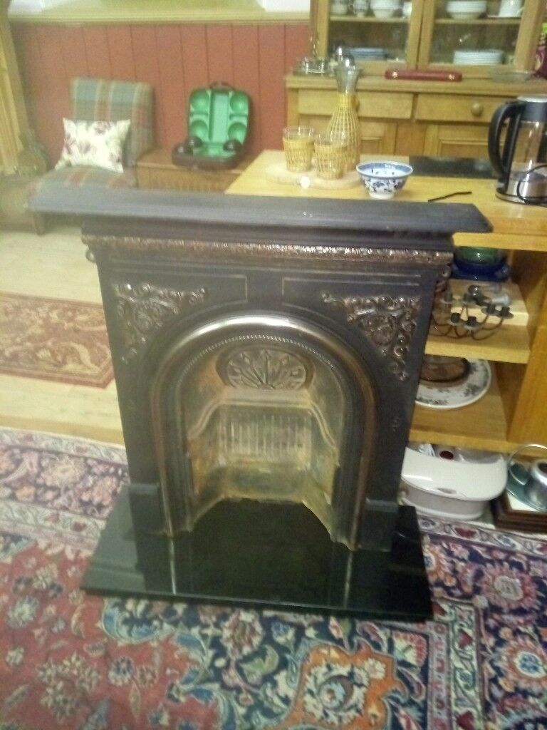 Cast Iron Fireplace with Black Granite Hearth.