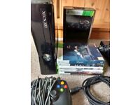 Xbox 360 S console + 6 games, controller and HDMI cable.