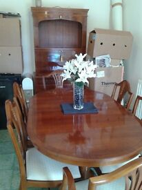 beautiful extending dinning table 6 chairs and cabinet.