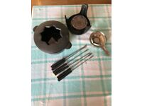 Swiss cast iron fondue kit for cheese or meat