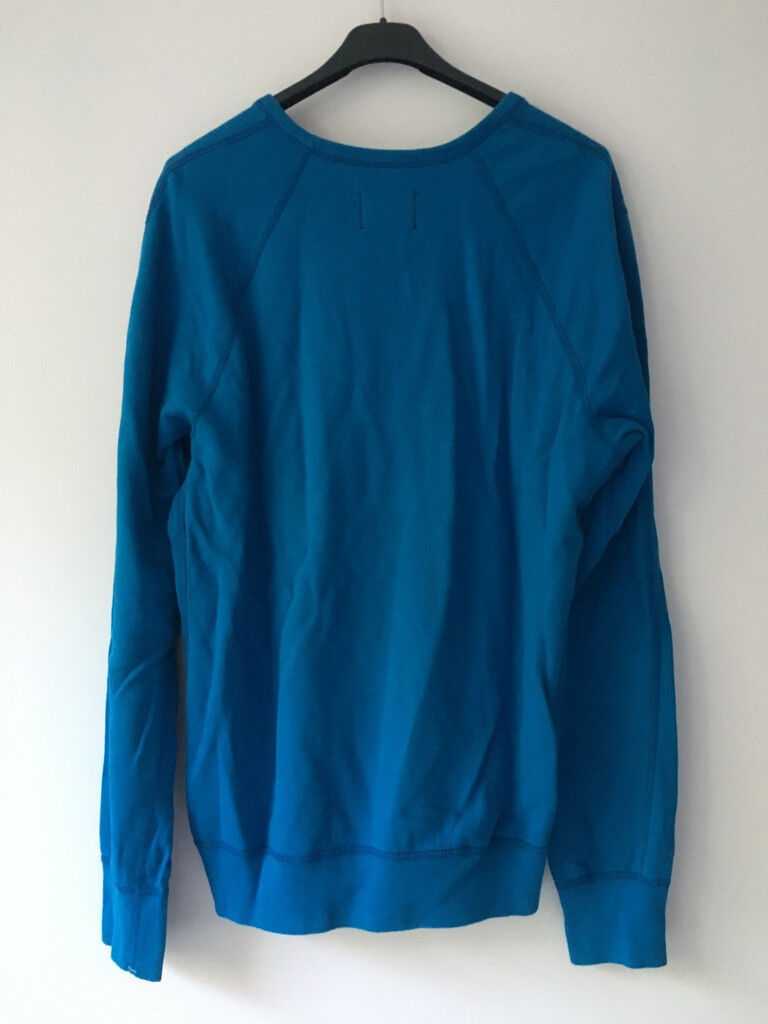 Sweat bleu pull jumper gomme canada supreme reigning champ m