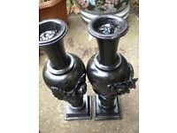 A PAIR OF BLACK STONE GARDEN VASES 16X5X5 INCHES
