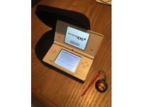 Nintendo DSi with charger carry case, Mario stylus and 1 game.