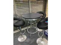 3x American diner high tables with 7 faux leather stools