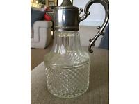 Antique Italian lead Crystal claret decanter with silver plate handle and top.