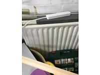 Various sizes radiators for sale plus a radiator cover