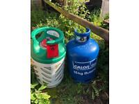Empty gas bottle (left/green one)