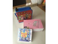 Nintendo pink 2DS with game and travel case