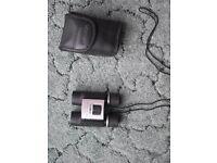 Minolta 10 x 25 binoculars with case