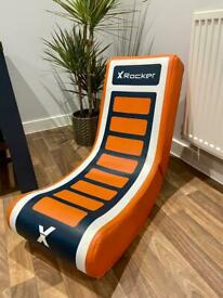 Rocker style gaming chair