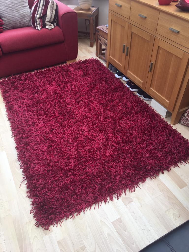 Red tassel rug