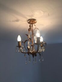 small brass chandelier with glass crystal drops