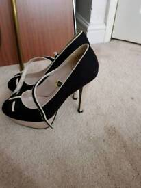 Size 7 black and white strap heels
