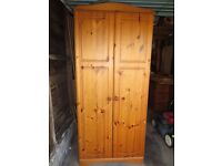 Antique Pine Finish Wardrobe, in reasonable condition. Hanging Rail inside.