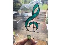 Treble clef stained glass piece