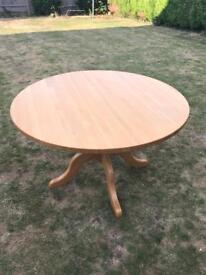 Solid wood round dining table and 4 dark brown leather chairs