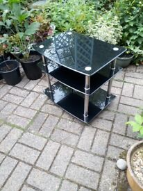 Tv stand- black glass, with silver legs, 3 tier