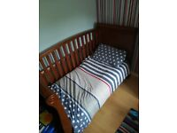 Solid wood cot bed