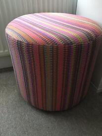Colourful striped foot stool and matching cushipn