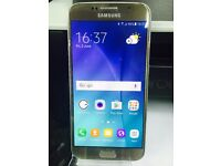 Samsung Galaxy S6 Smart Mobile phone unlocked. good condition Gold 32GB WITH warranty & Receipt