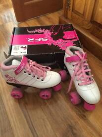 Roller boots size 4
