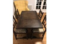 ERCOL EXTENDABLE ANTIQUE DINING TABLE AND FOUR CHAIRS