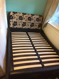 Black leather bed frame with patterned headboard