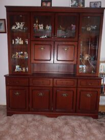 Mahogany coloured wall unit. In very nice condition.