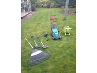Garden tools (lawnmower, trimmer, hose, spades, leaf rake)
