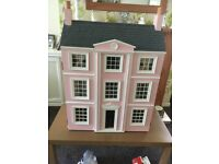 Dolls house three story lots of furniture and lots of people
